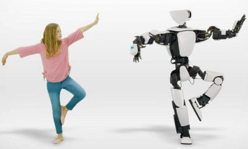 girl dancing with Toyota T-HR3 humanoid robot